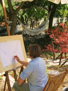 woman drawing in the garden