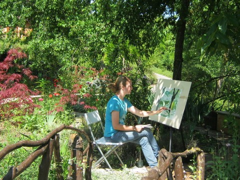 girl painting in the garden
